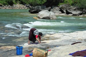 Washing clothes along the river in Bumthang.