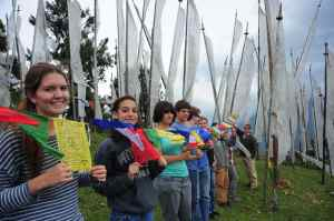Placing prayer flags on Chele La pass.