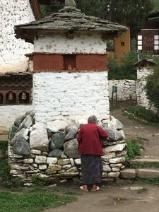Placing Offerings (berries) on the Chorten